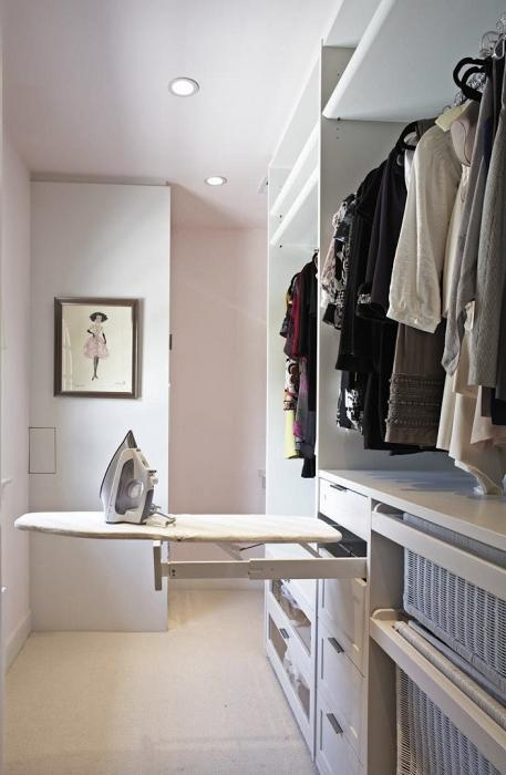 pull-out ironing board in the cupboard